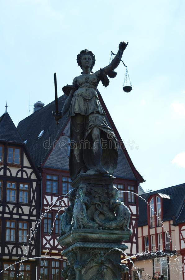 Lady justice on the Roemer place in Frankfurt royalty free stock photo