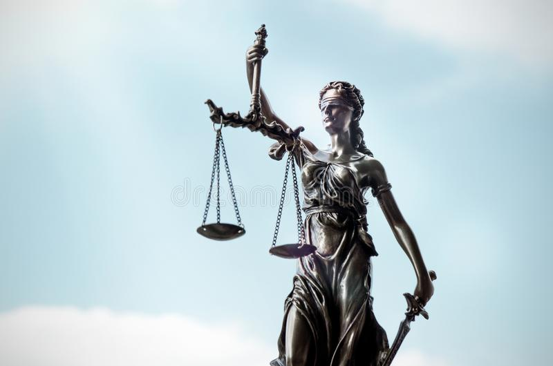 Lady justice, themis, statue of justice on sky background royalty free stock photo