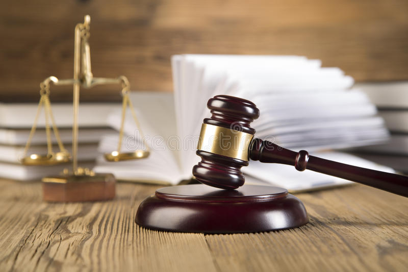 Lady of justice, Wooden & gold gavel and books stock images