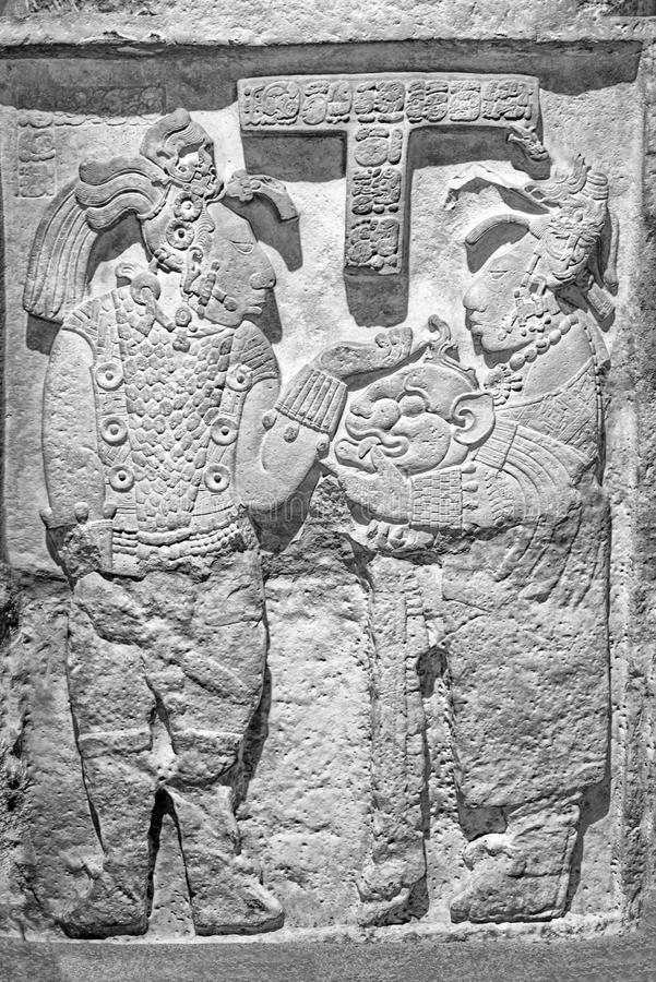 Lady K`abal Xook hands her husband, king Itzamnaaj Balam III, a jaguar helmet. National Museum of Anthropology, Mexico City stock image