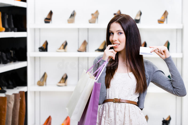 Lady Keeps Credit Card In Footwear Shop Royalty Free Stock Photos