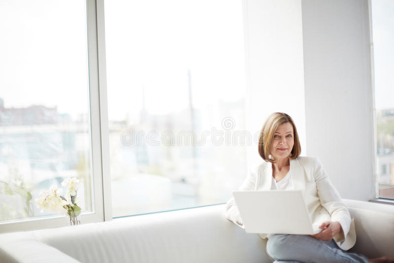 Lady with laptop stock images