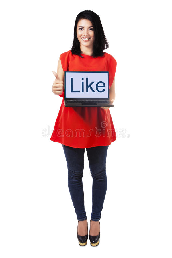 Lady with laptop showing thumb up. Full length of pretty woman holding laptop computer with a like text showing thumbs up, isolated on white stock images