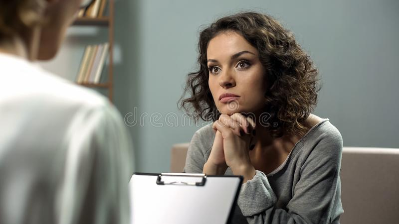 Lady listening attentively to her psychotherapist advice, mental health, hope. Stock photo royalty free stock photography