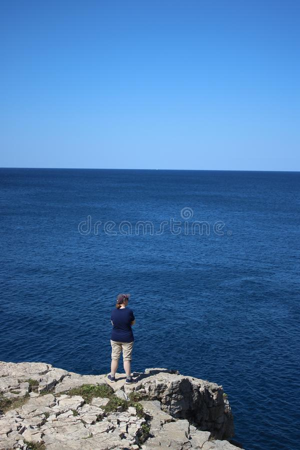 Lady looking out over Adriatic sea, Pula Croatia royalty free stock photos