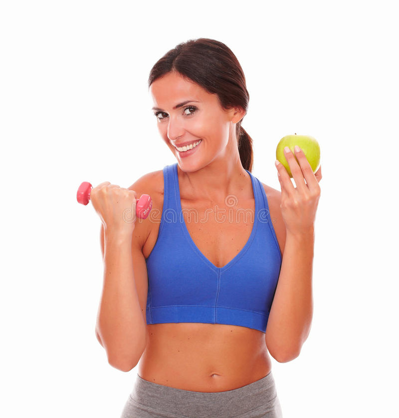 Lady losing weight with exercise and fruit stock images