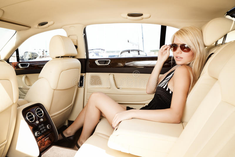 Lady in a luxury car royalty free stock image