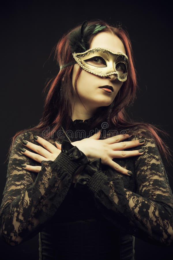 Lady in mask stock photos