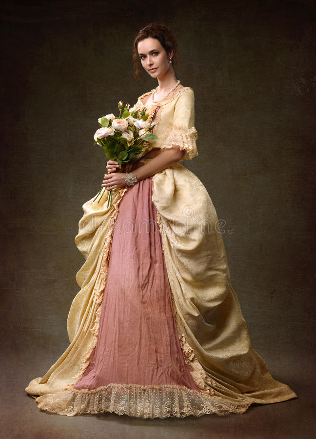 Lady in medieval yellow dress royalty free stock photography