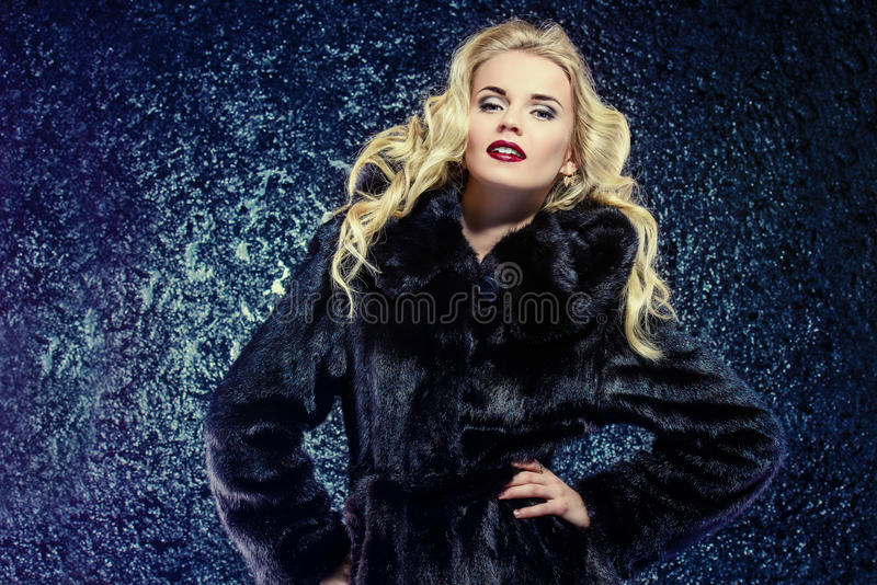 Lady in mink fur coat stock photo