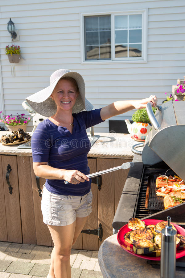 Lady by Outside Kitchen BBQ stock photo