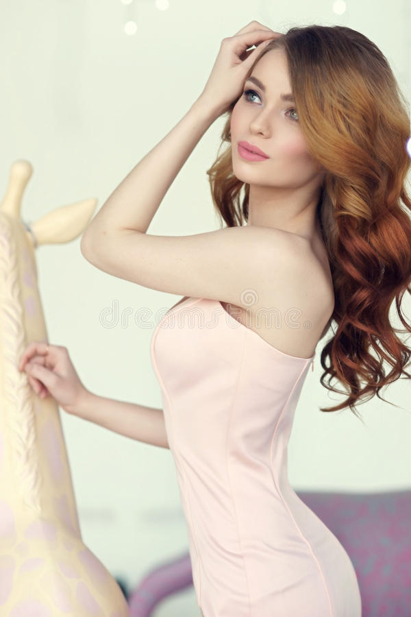 Lady in pink mermaid dress royalty free stock photo