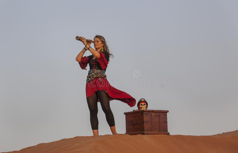 Lady pirate in a desert royalty free stock image