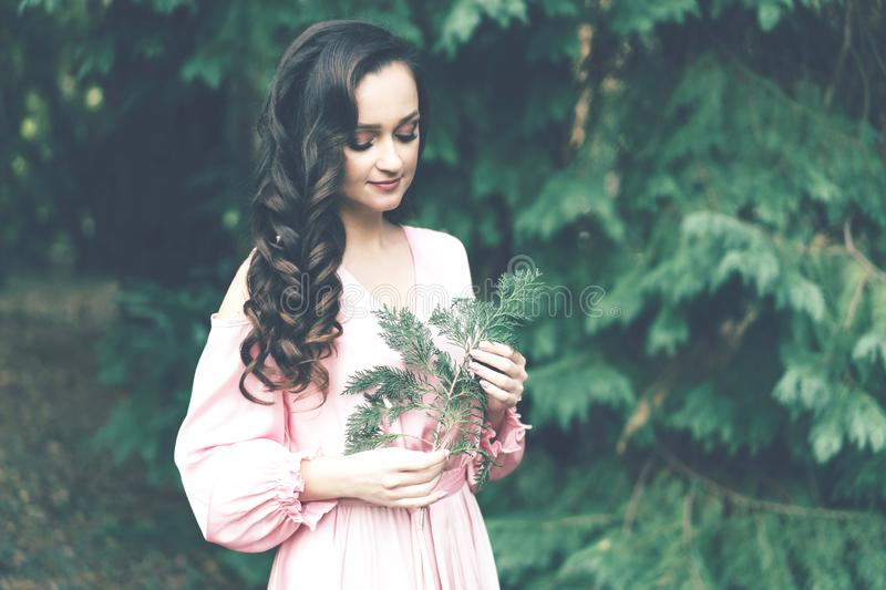 Lady with a plant branch stock photography
