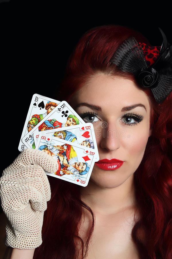 Lady with playing cards royalty free stock image