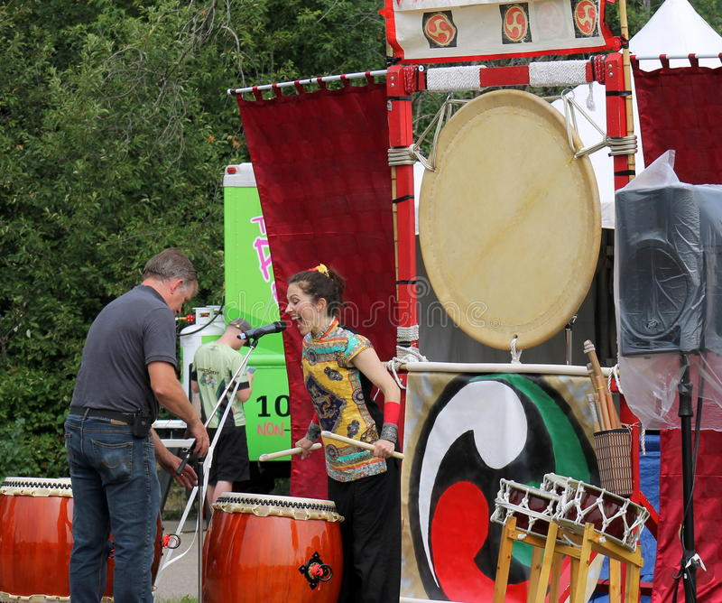 Lady playing drums at festival royalty free stock photos