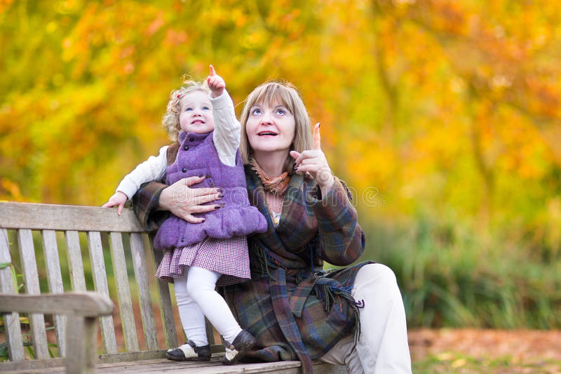 Download Lady Playing With Little Toddler Girl In Autumn Park Stock Image - Image of healthy, child: 41533365