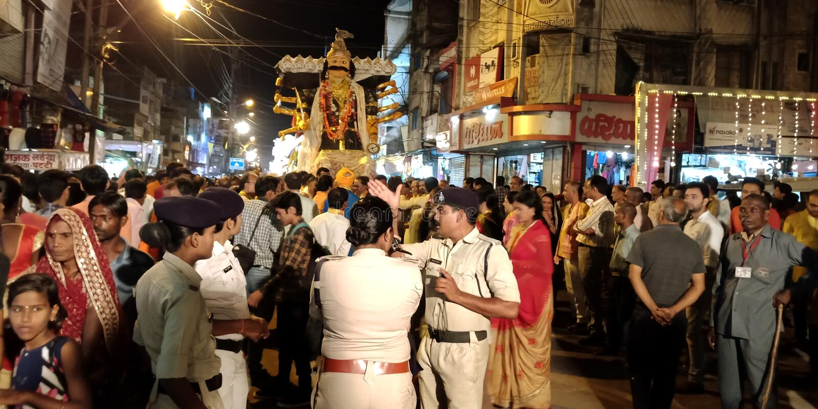 lady police commander standing on a group during Hindu religious festival road show stock photography