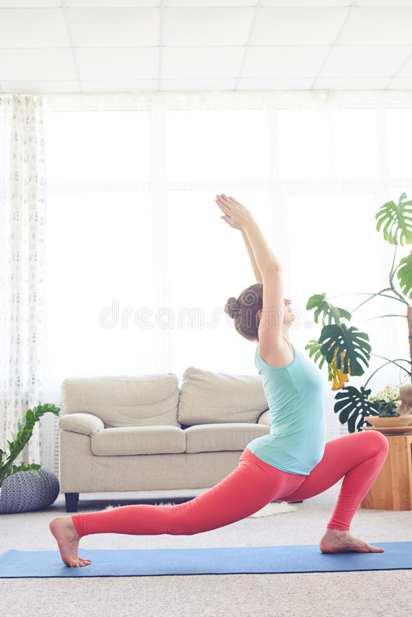 Lady practicing blaster pose with hands up. Elegant lady practicing blaster pose with hands up royalty free stock photos