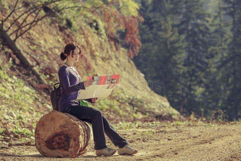 Lady reading travel map royalty free stock image