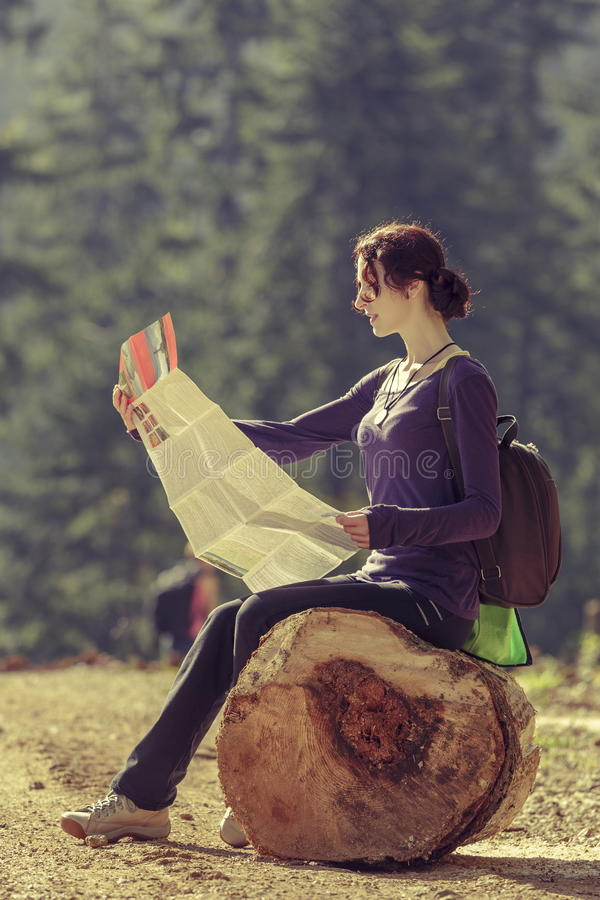 Lady reading travel map royalty free stock photography