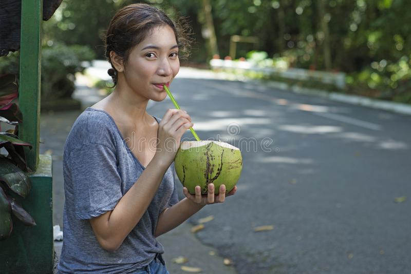Lady With Refreshing Coconut Juice stock photography