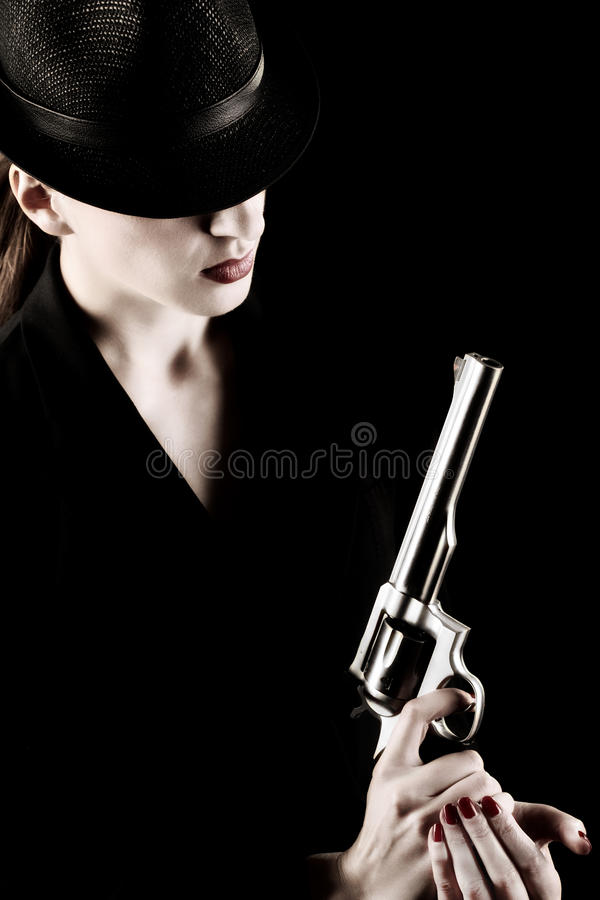 Lady with a revolver royalty free stock image