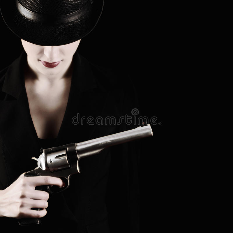 Lady with a revolver stock photography