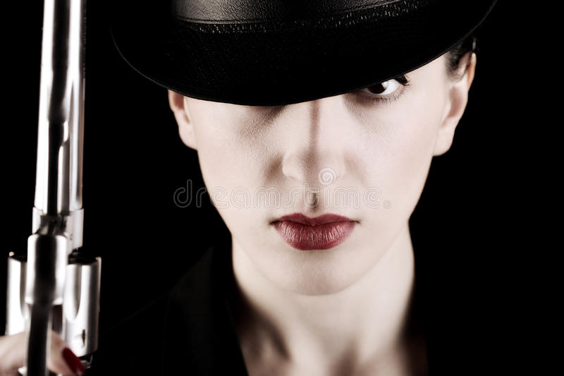 Lady with a revolver royalty free stock photos