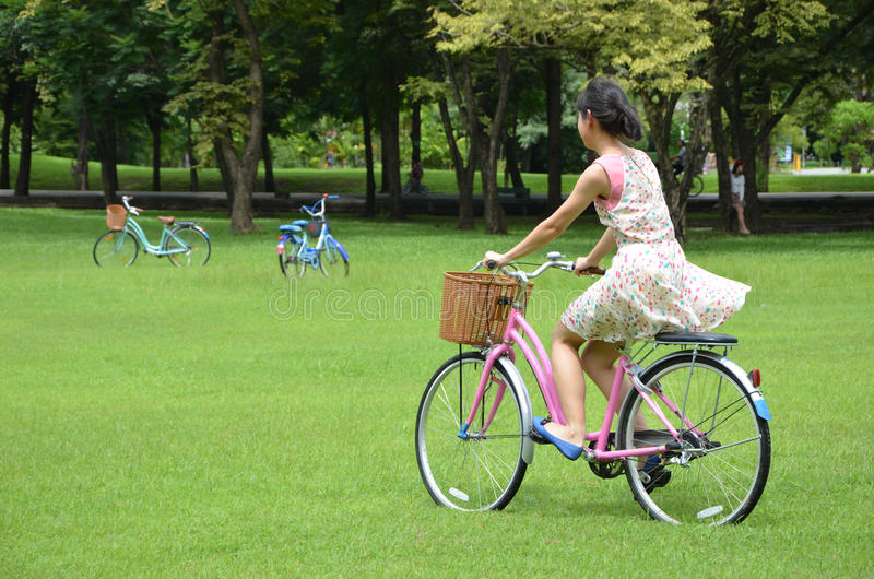 Lady Riding Bicycle. Little Lady Riding Pink Bicycle stock photography