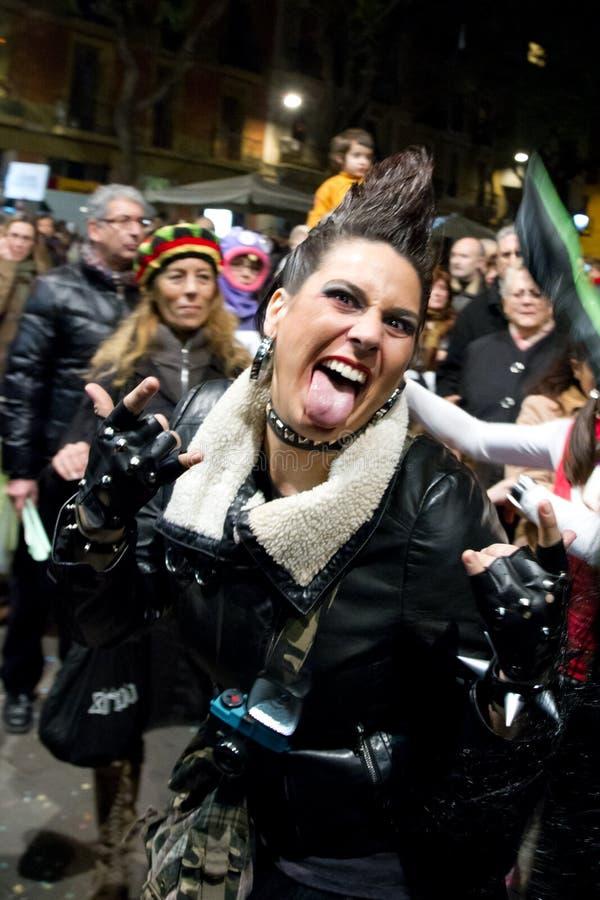 Lady in Rock Pose at Barcelona Carnival stock photo