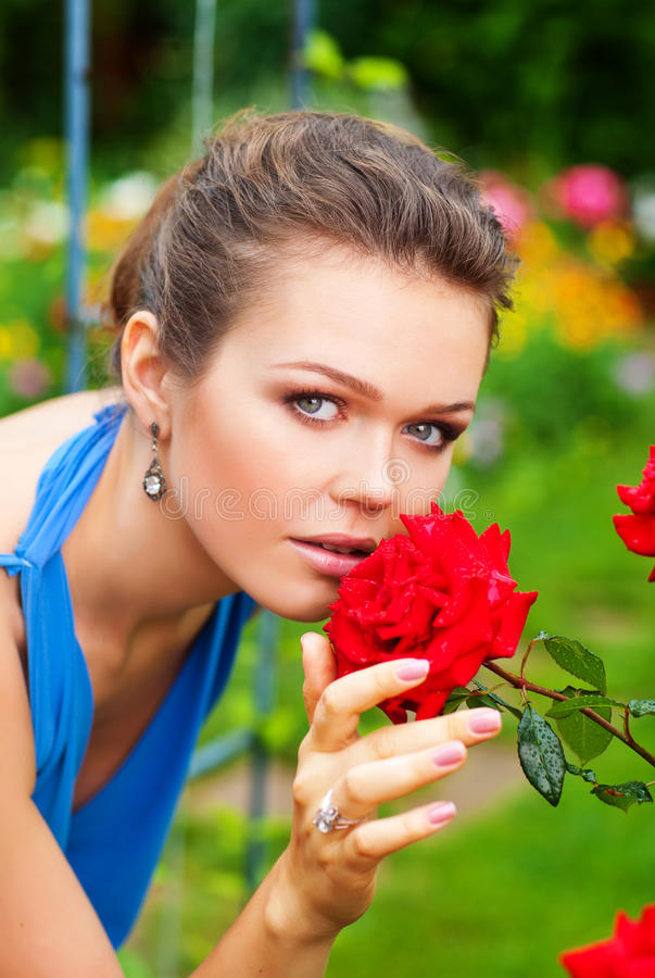 Lady with rose in garden stock images