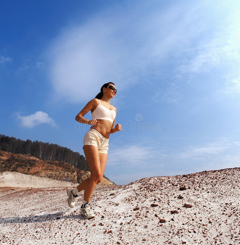 Lady running royalty free stock photography