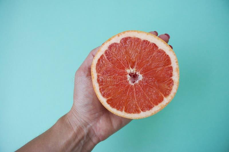 Halved grapefruit on blue background. stock images