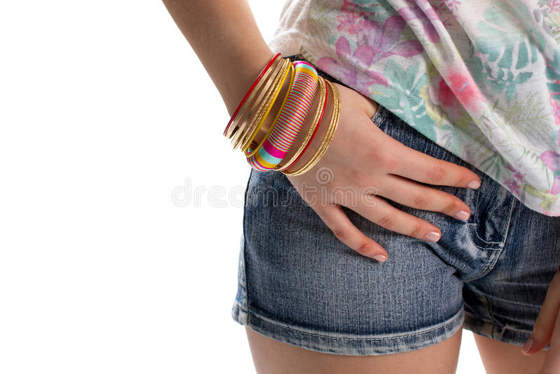 Lady's hand on shorts pocket. royalty free stock image