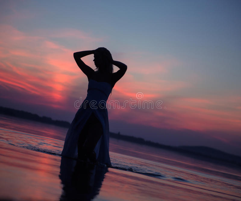 Lady's silhouette in the water royalty free stock photography