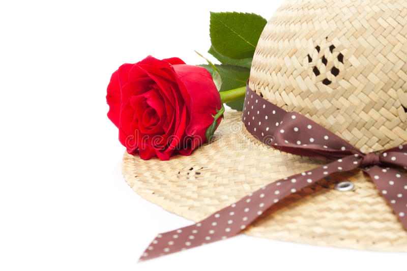 The Lady's still life with rose and elegant hat stock photo