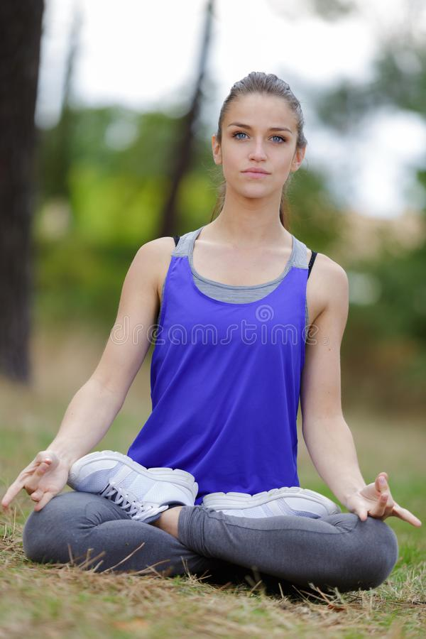Lady sat in lotus position. Lady stock photos