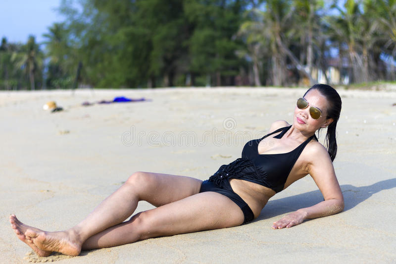 Lady shape swimsuit. In Ban Krut Beach, at Prachuap Khirikhun Province Thailand stock photos