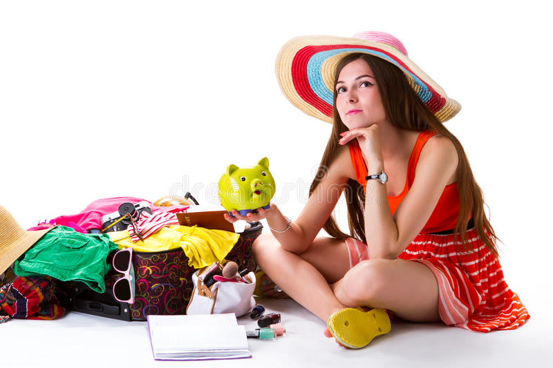 Lady sits beside overfilled suitcase. royalty free stock images