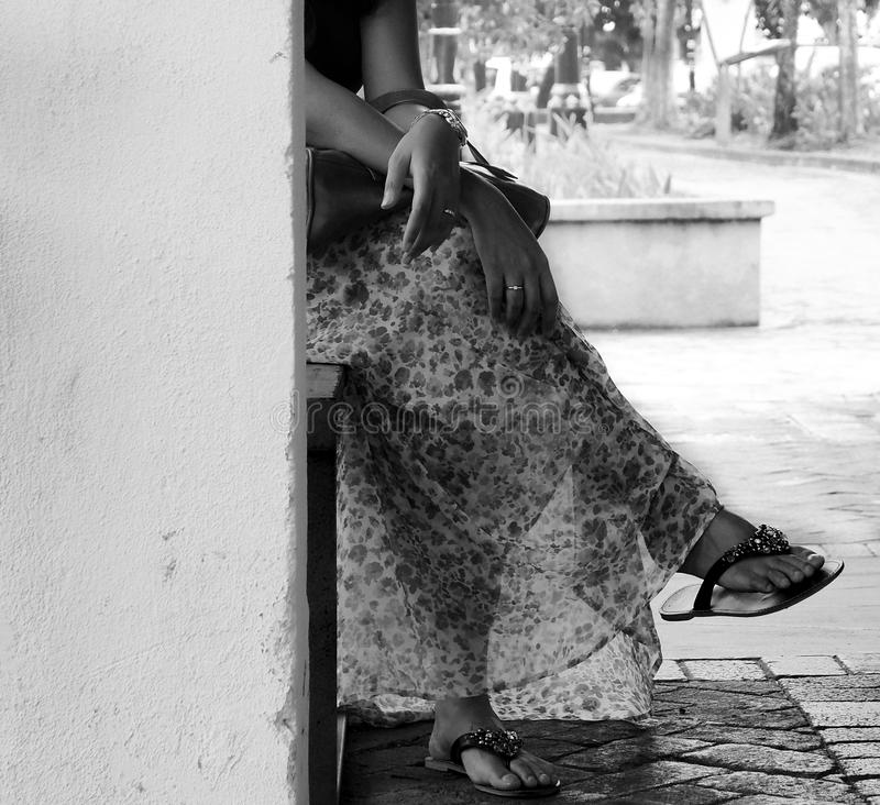 Lady sitting cross legged royalty free stock photos