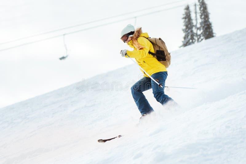 Lady skier rides at ski slope stock images
