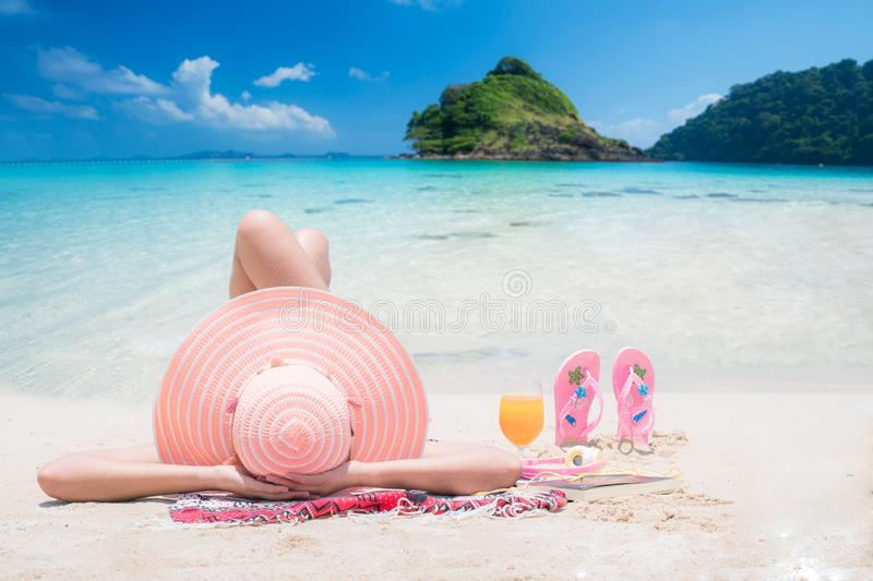Lady sleep and relax on the beach stock images