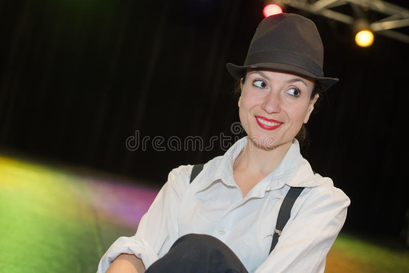 Lady on stage wearing hat stock images