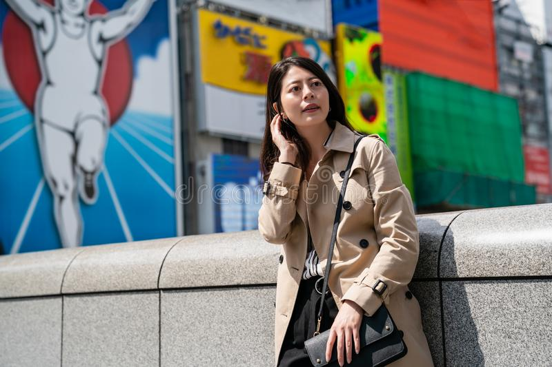 Lady standing in front famous glico running man stock image