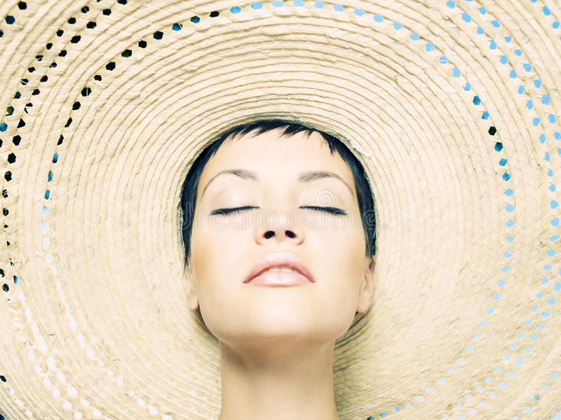 Lady In Straw Hat Royalty Free Stock Photography
