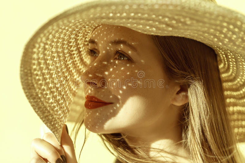 Lady in straw hat in summer stock photo