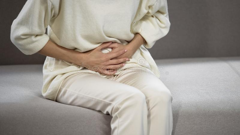 Lady suffering from strong stomach ache, gastritis, problems with gall bladder stock image