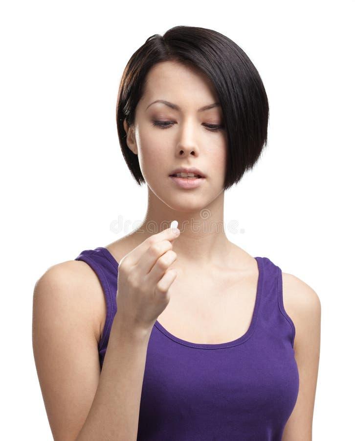 Lady takes vitamins stock image