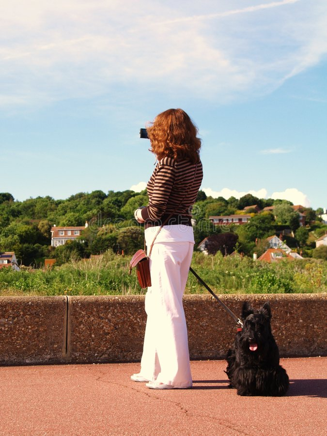 Lady Taking Photograph With Dog Stock Photo